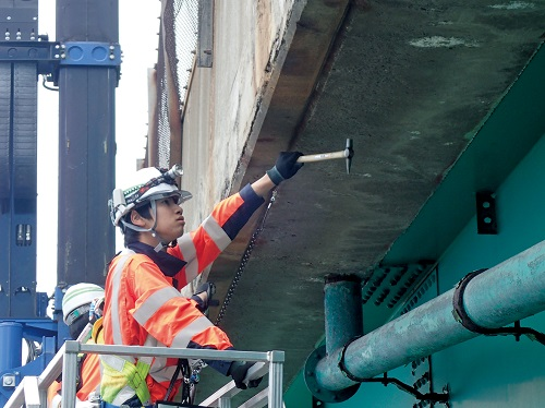 Photo of tap sound inspection of bridge